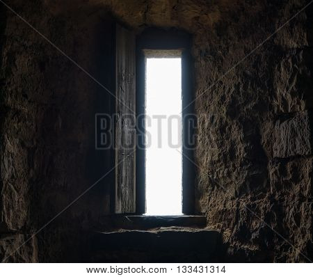 Dark room with stone walls and window