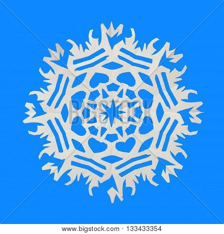 On a blue background lie a paper snowflake
