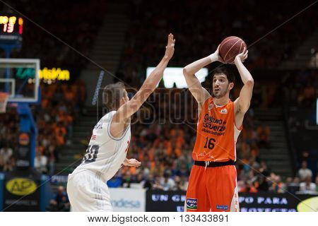 VALENCIA, SPAIN - JUNE 7th: Guillem Vives with ball and Carroll during 3rd playoff match between Valencia Basket and Real Madrid at Fonteta Stadium on June 7, 2016 in Valencia, Spain