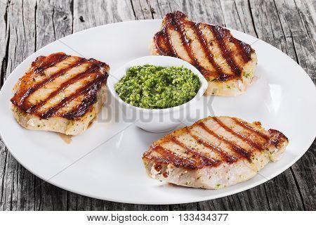 fried pork chops marinated with pesto sauce