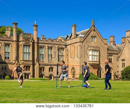 NEWSTEAD ABBEY JUNE 5: A group of young men playing Sepak Takraw (kick volleyball) on the lawn. At Newstead Abbey Nottinghamshire England. On 5th June 2016.