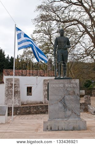 Chania Crete - April 7 2015: Famous Statue of Eleftherios Venizelos at the village of Therissos at Chania distric in the island of Crete Greece with the greek flag on the side.