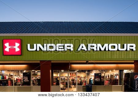 Oshkosh WI - 5 June 2016: Under armour store sign illuminated at night