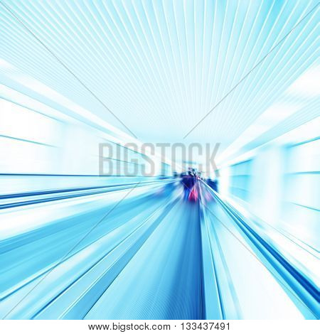 Abstract image of moving walkway and blurred people on background.