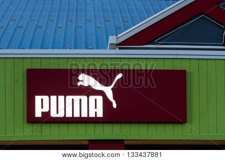 Oshkosh WI - 5 June 2016: Puma store sign illuminated at night