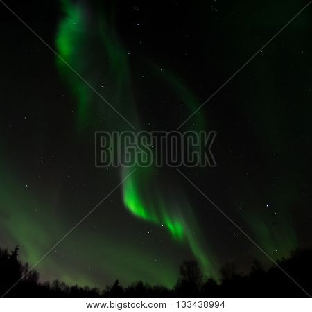 A ribbon of light is the result of an aurora racing across the sky.