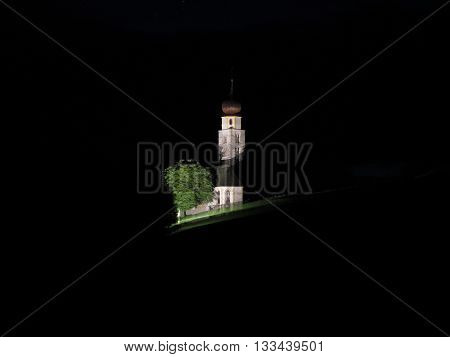 Panoramic view of San Valentino church in Castelrotto South Tyrol - Italy by night
