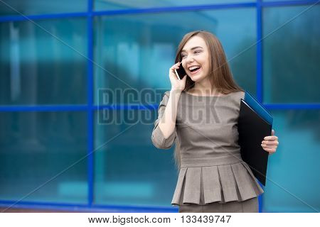 Portrait Of Business Woman Laughing While Talking On Mobile Phone. Copy Space