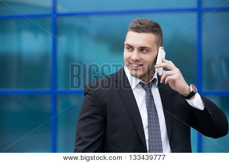 Portrait Of Happy Business Man On Smartphone. Copy Space