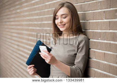 Portrait Of Young Woman Using Phone On The Street