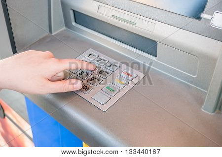 Hand Is Entering Pin Code In Atm Machine To Withdraw Cash. Banki