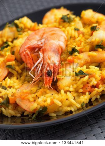 Seafood risotto with shrimps curry and herbs. Vertical shot close up