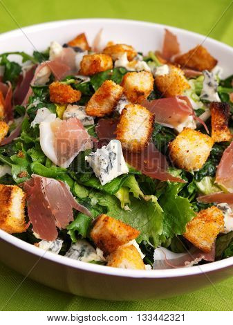 French Provencal Salad with green salad bacon croutons and blue cheese. Close up