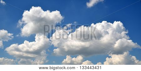 Summer clouds flying in the deep blue sky clouds background