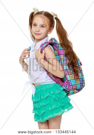 charming little girl with long bright tails on the head, in a short green skirt, carries a schoolbag-Isolated on white background