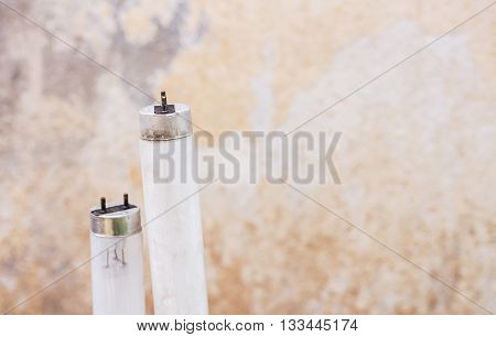 Selected focus fluorescent light tube.Short depth-of-field. Old fluorescent light tube with grunge wall background