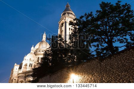 The basilica Sacre Coeur in evening Paris France.