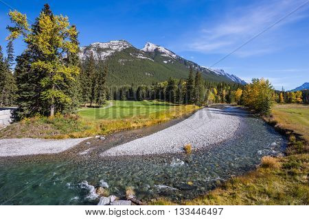Autumn day in the Canadian Rockies. Dry creek in Banff National Park