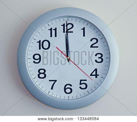 Wall Clock. Blue wall clock with arrows.
