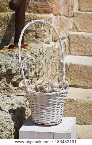 Wicker basket for wedding party on staircase castle.
