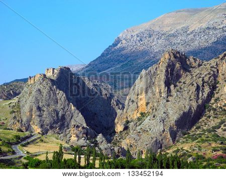 Landscape Mountains with the ruins of the fortress of Derik in Turkey.