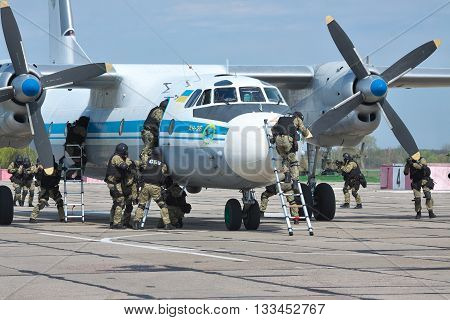 Kiev Region Ukraine - April 24 2012: Special operations sercice squad during the counter-terrosist training with a captured plane in the airport