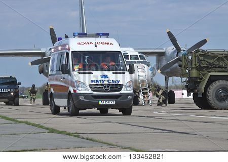 Kiev Region Ukraine - April 24 2012:Ambulance is evacuating the victims during the Special operations sercice squad at the counter-terrosist training with a captured aircraft