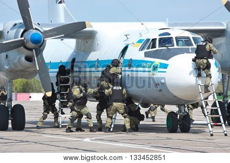 Kiev Region Ukraine - April 24 2012: Special operations sercice squad during the counter-terrosist training with a captured plane