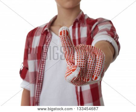 Cute teenager boy in red checkered shirt and building gloves pushing something something with finger over white isolated background, half body, constructing concept