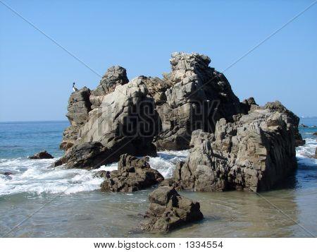 Rocks On The Surf