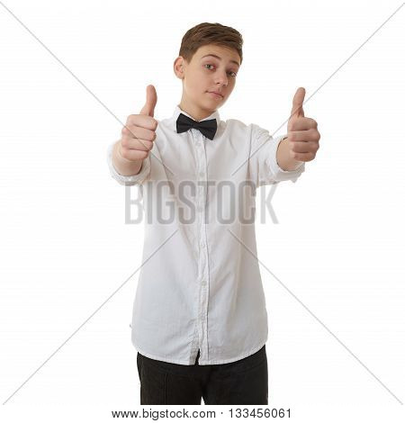 Cute teenager boy in white shirt and black bow tie showing thumb up sign over white isolated background, half body