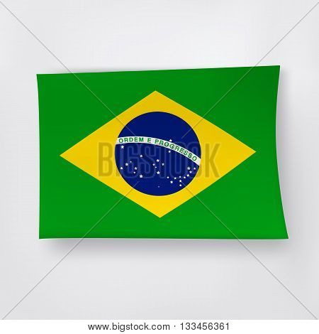 Brazilian flag on the white background with shadows.