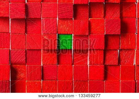 Wall Of Red Toy Blocks, Green Block In The Middle