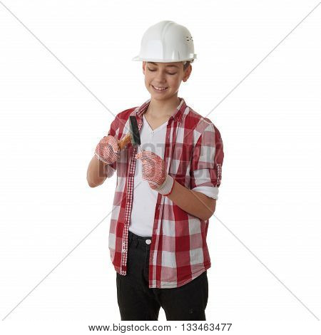 Cute teenager boy in red checkered shirt, building helmet and hammer over white isolated background, half body, constructing concept
