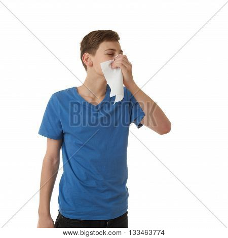 Cute teenager boy in blue T-shirt with handkerchief over white isolated background, half body, sickness concept