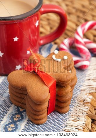 Homemade gingerbread man cookie with red ribbon