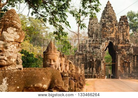 Faces at the entrance of Bayon Temple in Angkor Wat Cambodia