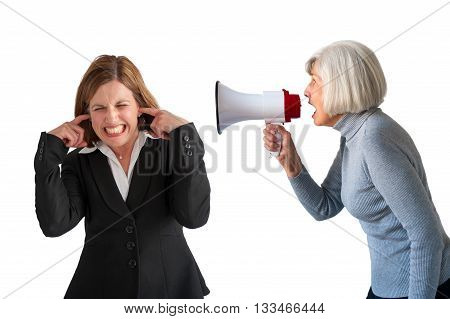mature woman being shouted at by senior woman on white