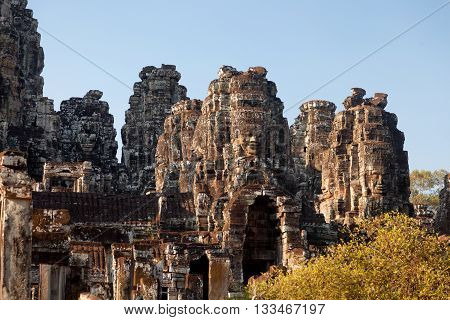 Dramatic view at sunset of Bayon Temple in Angkor Thom Angkor district Siem Reap Cambodia