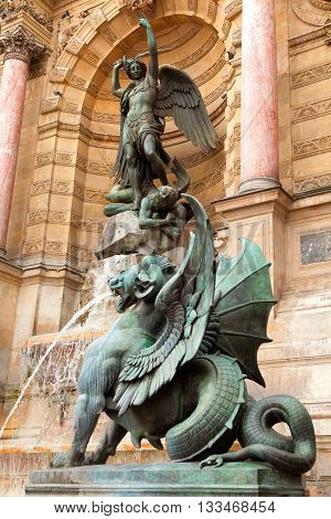 The statue of Saint Michael atop the fountain in the Place Saint-Michel at the northern end of the Boulevard Saint-Michel.