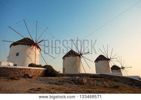 Row of four windmills at sunset in Mykonos island Greece