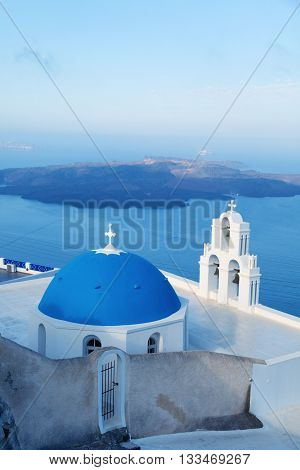 Famous orthodox church in Fira Santorini early in the morning with wonderful view to the sea and caldera