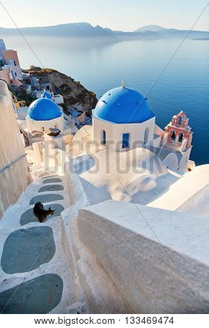 Churches and stairs in Oia Santorini. Shot at sunset. Vertical view.