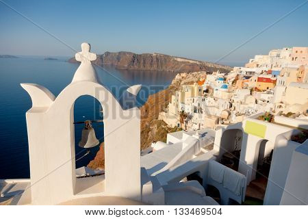 Cityscape of Oia Santorini with church on foreground