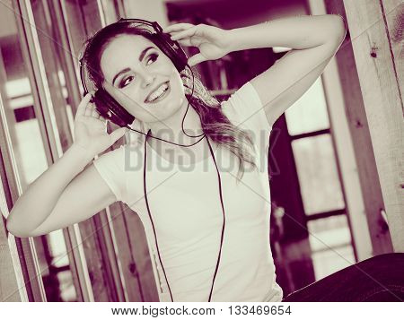 Hobby music expression and free time. Young girl listen music dance with hands on headphones.
