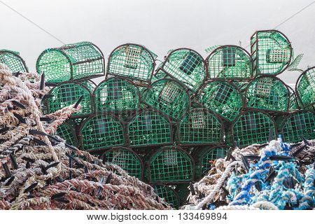 A stack of traps for catching fish and shellfish. On the quay of the sea.