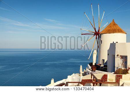 Windmill in Oia town Santorini Greece. Horizontal shot