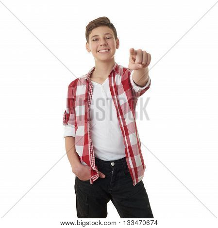 Cute teenager boy in red checkered shirt poinitng forward over white isolated background, half body