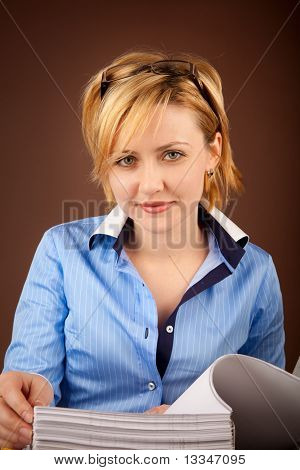 Businesswoman Checks The Documents In A Folder
