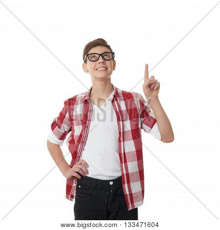 Cute teenager boy in red checkered shirt and glasses pointing up over white isolated background, half body